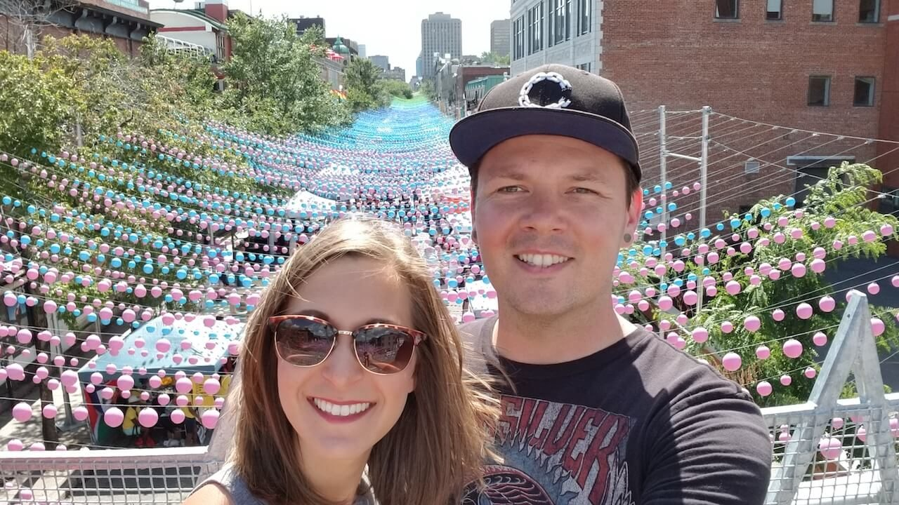 Liz and Dennis in front of St. Catherines Street Montreal with Colored Hanging Balls