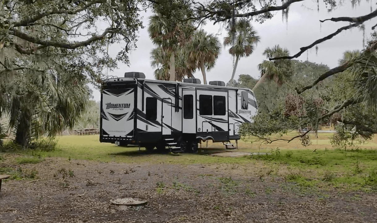 Grand Design Momentum 328M Free Camping in Florida under Oak Hammock